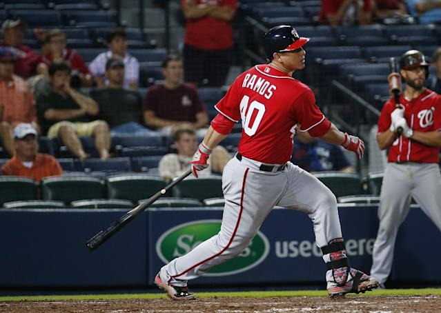 Washington Nationals catcher Wilson Ramos (40) puts his team ahead with an RBI single in the eleventh inning of a baseball game against the Atlanta Braves Sunday, Aug. 10, 2014 in Atlanta. Nationals won 4-1. (AP Photo/John Bazemore)