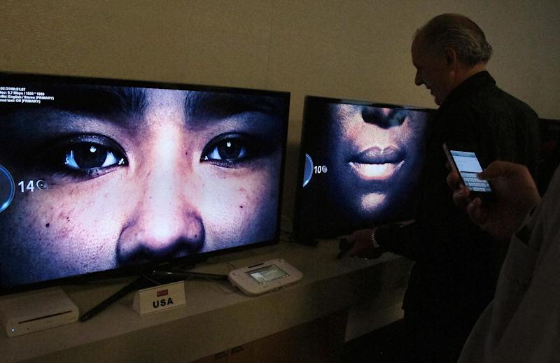 """In this photo taken Wednesday, July 10, 2013, invited guests view the debut of the new series """"Orange is the new black"""" at Netflix headquarters in Los Gatos, Calif. (AP Photo/Michael Liedtke)"""