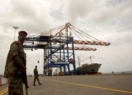 FILE PHOTO: A Djibouti policeman stands guard during the opening ceremony of Dubai-based port operator DP World's Doraleh container terminal in Djibouti port February 7, 2009. REUTERS/Ahmed Jadallah/File Photo