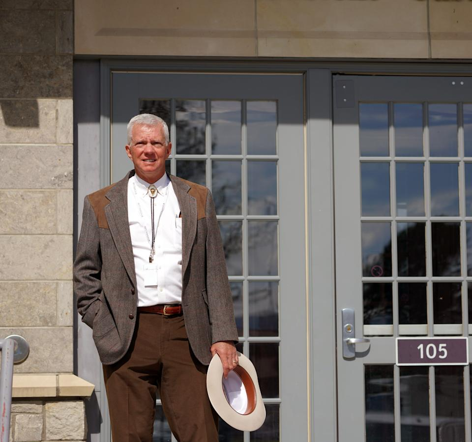 Federal Magistrate Judge Mark L. Carman stands on the front steps of the federal court building in Mammoth Hot Springs at Yellowstone National Park.