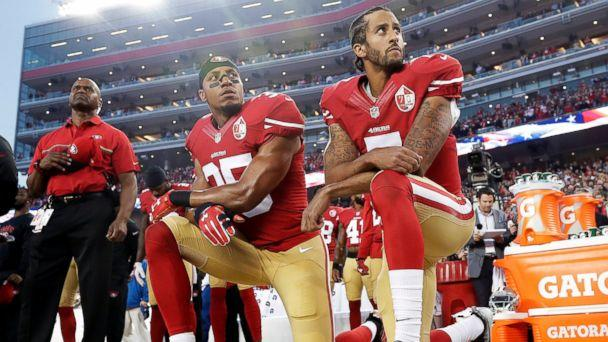 In this Monday, Sept. 12, 2016, file photo, San Francisco 49ers safety Eric Reid (35) and quarterback Colin Kaepernick (7) kneel during the national anthem before an NFL football game against the Los Angeles Rams. (AP Photo/Marcio Jose Sanchez)
