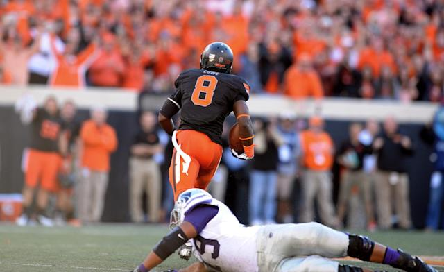 Kansas State offensive lineman Keenan Taylor, bottom, falls short of tackling Oklahoma State's Daytawion Lowe (8) as he returns a 72-yard interception during an NCAA football game in Stillwater, Okla., Saturday, Oct. 5, 2013. Oklahoma State won 33-29. (AP Photo/Brody Schmidt)