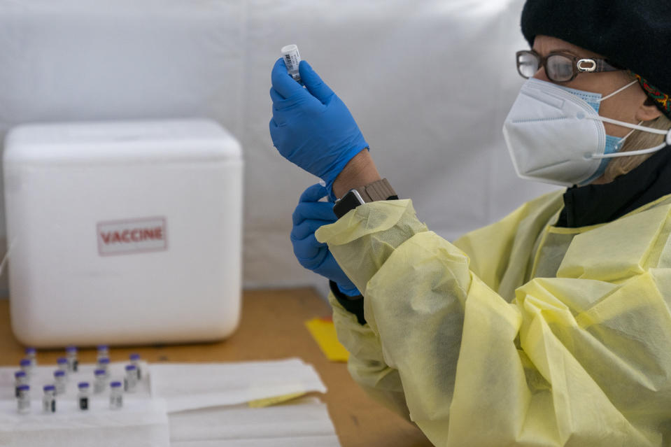 A pharmacist fills a syringe with the Pfizer-BioNTech COVID-19 vaccines at a pop-up vaccination site at the God's Battalion of Prayer Church, Wednesday, Feb. 3, 2021, in the Brooklyn borough of New York. SOMOS and Elderplan volunteer nurses are expected to vaccinate up to 500 older New Yorkers who attend the church or live in surrounding areas. (AP Photo/Mary Altaffer)