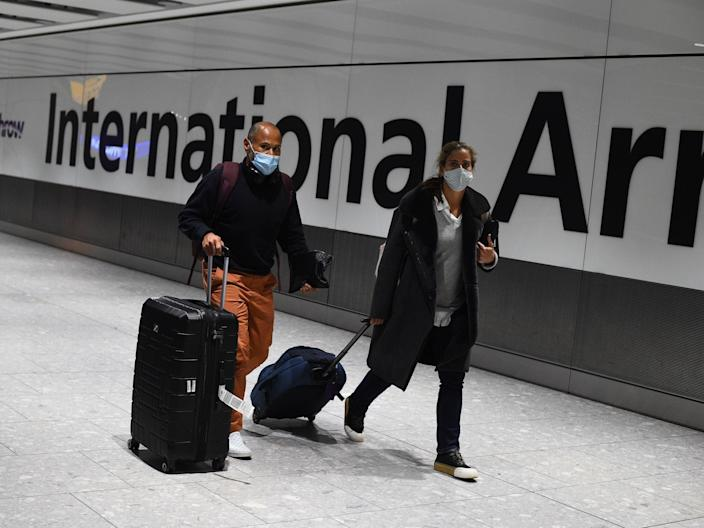 Prime minister Boris Johnson is expected to approve plans to force some travellers arriving to the UK to quarantine in hotels to limit the spread of new coronavirus variant (Kirsty O'Connor/PA)