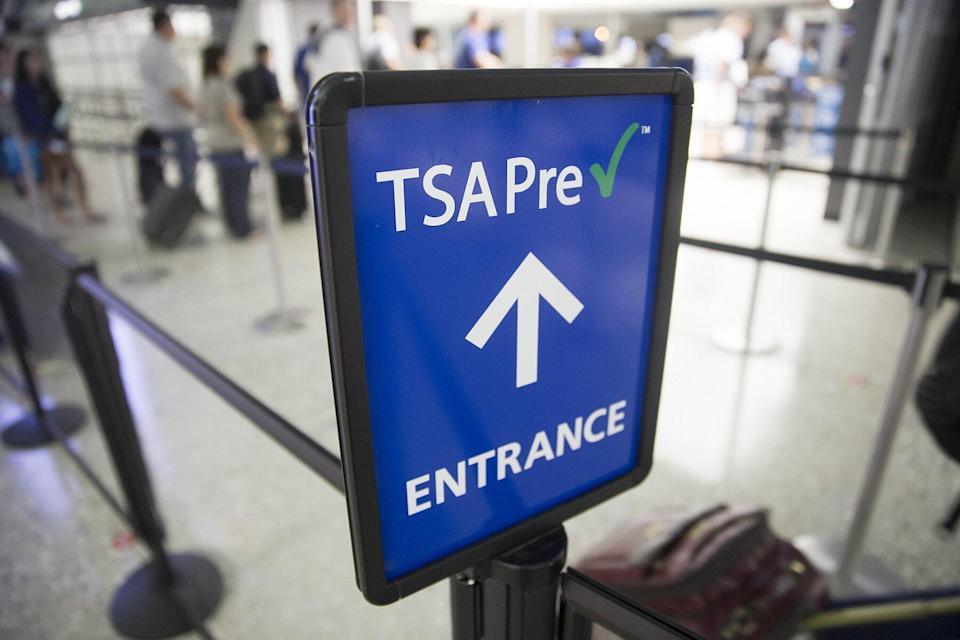 A Transportation Security Administration (TSA) pre-check sign stands at Dulles International Airport