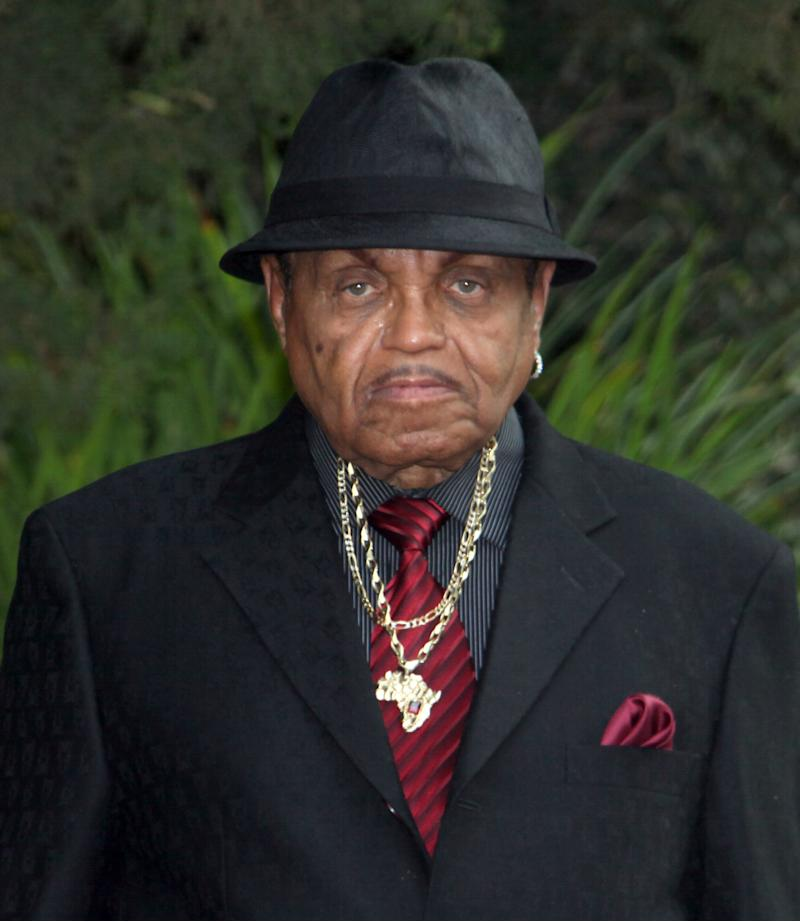 FILE - In this Sept. 3, 2009 file photo, Michael Jackson's father Joe Jackson leaves the family residence in the Encino section of Los Angeles for his son's funeral. Joe Jackson dismissed his wrongful death lawsuit against the former physician Conrad Murray convicted of involuntary manslaughter on Monday Aug. 13, 2012. (AP Photo/Nick Ut, File)