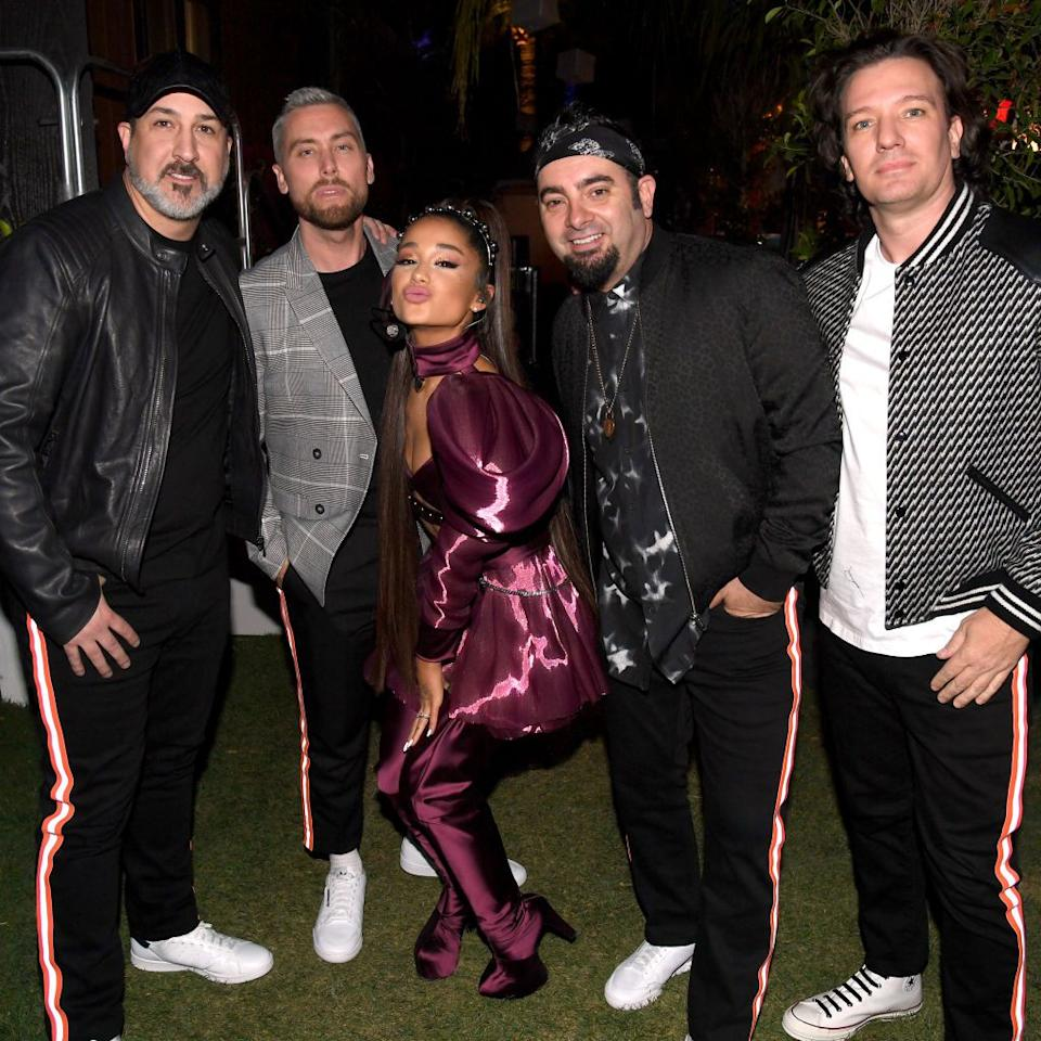 <p>*NSYNC's Joey Fatone, Lance Bass, Chris Kirkpatrick, and JC Chasez perform with Ariana Grande at Coachella on April 14, 2019.</p>