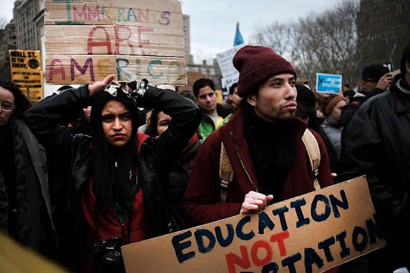 People attend a demonstration against the immigration polices of U.S. President Donald Trump in Washington Square Park on February 11, 2017 in New York City (AFP Photo/SPENCER PLATT)