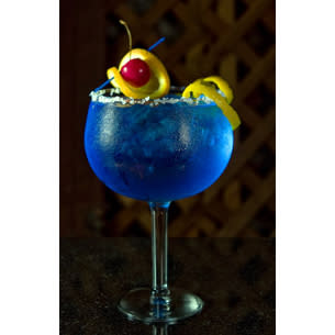 Blue bruiser - Place the ice, vodka, blue curacao, cranberry juice and lime juice in a highball glass. Stir with a mixing spoon for 8-10 seconds and garnish it with pineapple slice