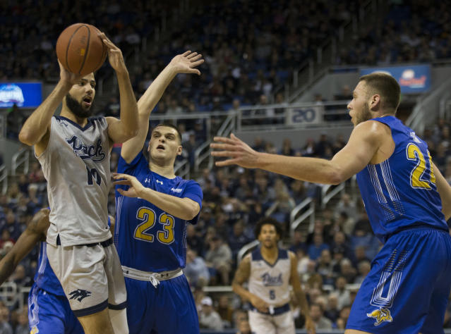 Nevada forward Cody Martin (11) looks to pass against South Dakota State in the first half of an NCAA college basketball game in Reno, Nev., Saturday, Dec. 15, 2018. (AP Photo/Tom R. Smedes)