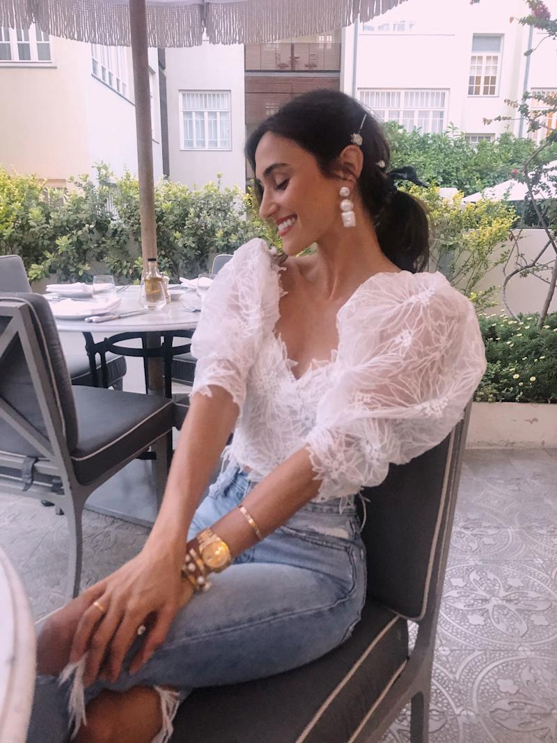 Wearing Israeli designer Dana Harel—she custom made me this top as a wedding gift. Earrings are from the Dannijo bridal collection I designed to wear during my wedding weekend.