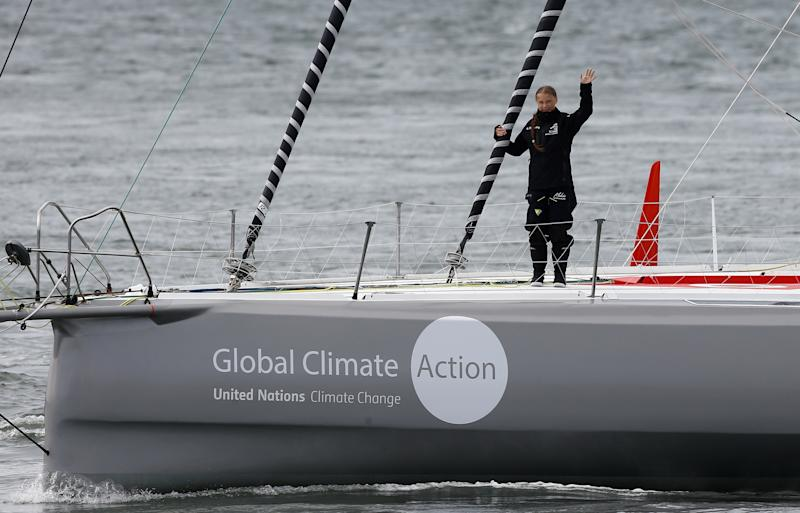 Swedish teenage climate activist Greta Thunberg waves from a yacht as she starts her trans-Atlantic boat trip to New York, in Plymouth, Britain, August 14, 2019. REUTERS/Henry Nicholls