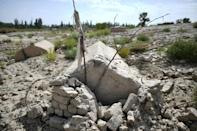 China is destroying burial grounds where generations of Uighur families have been laid to rest, leaving behind human bones and broken tombs in what activists call an effort to eradicate the ethnic group's identity in Xinjiang