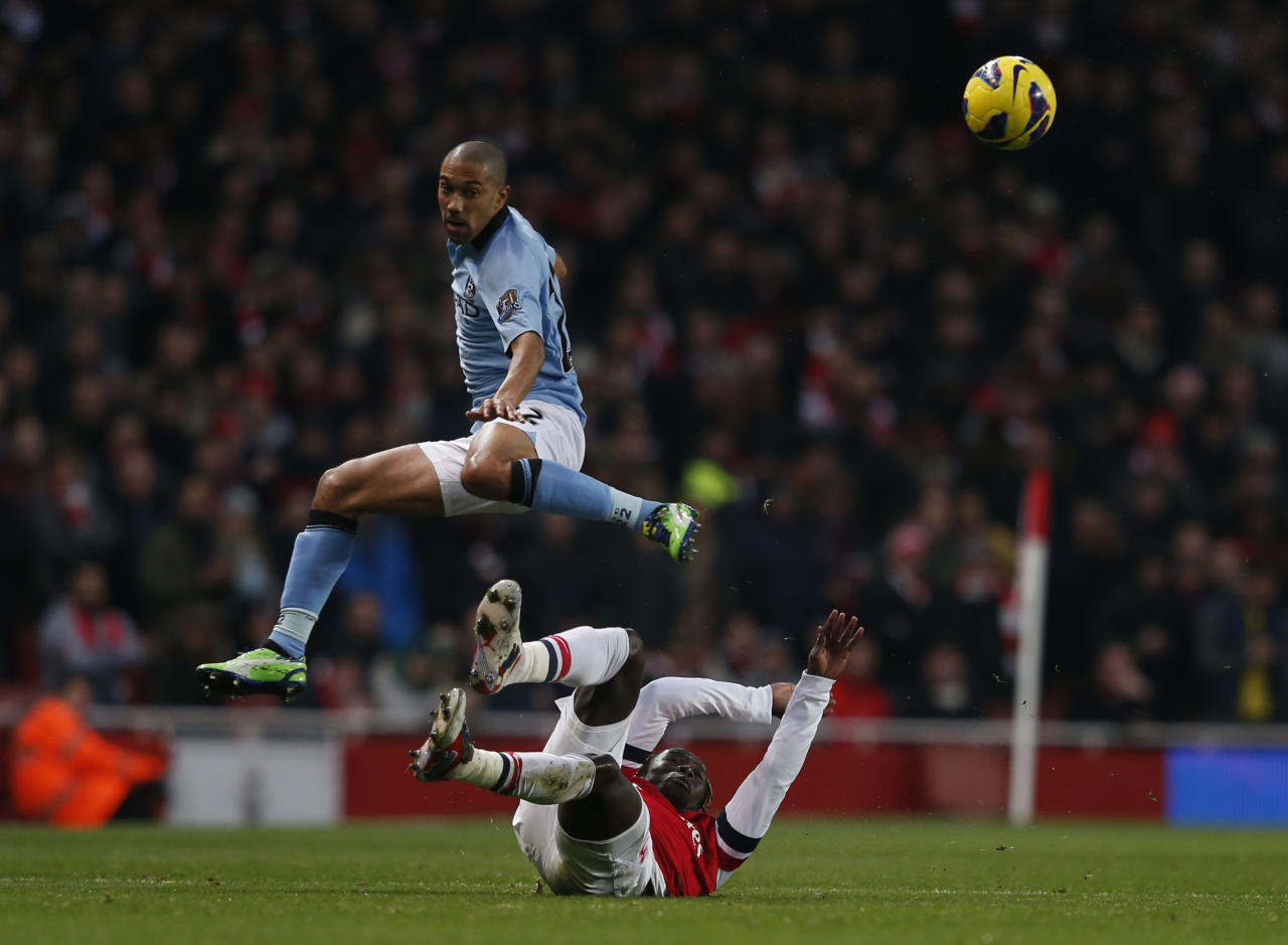 "Arsenal's Bacary Sagna (bottom) challenges Manchester City's Gael Clichy during their English Premier League soccer match at the Emirates Stadium in London January 13, 2013.   REUTERS/Eddie Keogh (BRITAIN - Tags: SPORT SOCCER) NO USE WITH UNAUTHORIZED AUDIO, VIDEO, DATA, FIXTURE LISTS, CLUB/LEAGUE LOGOS OR ""LIVE"" SERVICES. ONLINE IN-MATCH USE LIMITED TO 45 IMAGES, NO VIDEO EMULATION. NO USE IN BETTING, GAMES OR SINGLE CLUB/LEAGUE/PLAYER PUBLICATIONS. FOR EDITORIAL USE ONLY. NOT FOR SALE FOR MARKETING OR ADVERTISING CAMPAIGNS"
