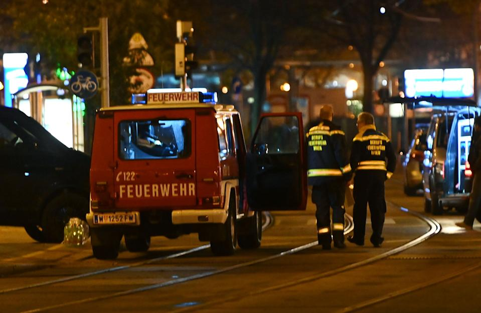 Firefighters and police cars stand near Schwedenplatz square following a shooting in the center of Vienna on November 2, 2020,. - Two people, including one attacker, have been killed in a shooting in central Vienna, police said late November 2, 2020. At least one attacker was still at large after a terror attack Monday evening in Vienna which killed one person, Austrian Interior Minister Karl Nehammer said, with another assailant shot dead. (Photo by Joe Klamar / AFP) (Photo by JOE KLAMAR/AFP via Getty Images)