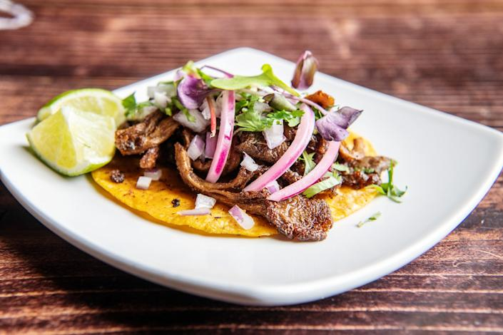 "A carnitas taco from Masataco. The Whittier restaurant has more than 15 vegan tacos on the menu. <span class=""copyright"">(Mariah Tauger / Los Angeles Times)</span>"