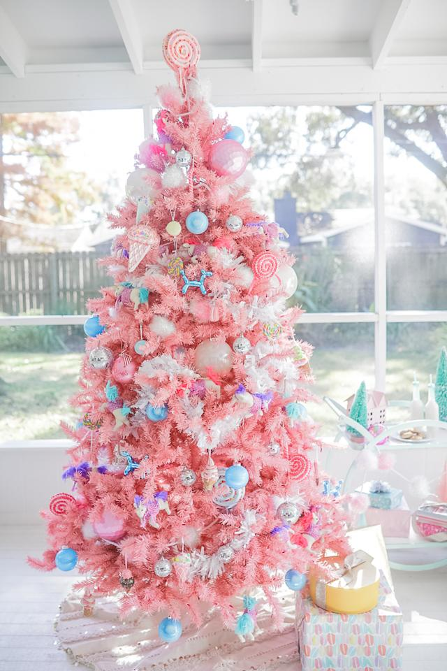 "<p>This pretty-in-pink tree features treats like ice cream and lollipops for sweetness and disco-ball ornaments for sparkle. Blogger <a rel=""nofollow"" href=""https://www.instagram.com/cakeandconfetti/"">Meredith Timms Staggers</a> came up with the idea for her daughter's backyard birthday party (complete with fake snow and a shed-turned-gingerbread house).<br />(Photo courtesy of Meredith Timms Staggers) </p>"