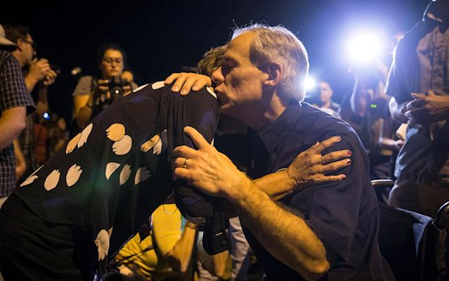 <p>Texas Governor Greg Abbott embraces a woman at a vigil following a mass shooting at the First Baptist Church in Sutherland Springs, Texas, Nov. 5, 2017. (Photo: Nick Wagner/AMERICAN-STATESMAN via Reuters) </p>