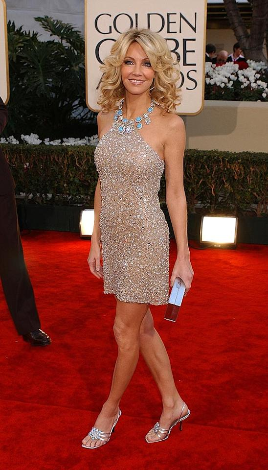 "Our favorite TV vixen Heather Locklear, best known as the devious Amanda Woodward on ""Melrose Place,"" put women half her age to shame in this gorgeous bejeweled cocktail dress, turquoise accessories, and strappy sandals from 2002. Gregg DeGuire/<a href=""http://www.wireimage.com"" target=""new"">WireImage.com</a> - January 20, 2002"