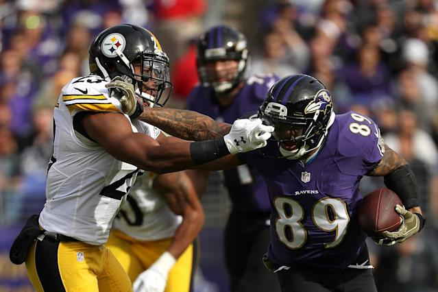 <p>Wide receiver Steve Smith #89 of the Baltimore Ravens carries the ball against free safety Mike Mitchell #23 of the Pittsburgh Steelers in the first quarter at M&T Bank Stadium on November 6, 2016 in Baltimore, Maryland. (Photo by Patrick Smith/Getty Images) </p>
