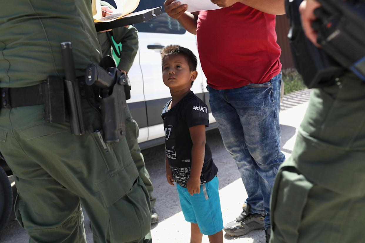 A boy from Honduras and his father are taken into custody by Border Patrol agents in June 2018 near Mission, Texas. (Photo: John Moore/Getty Images)