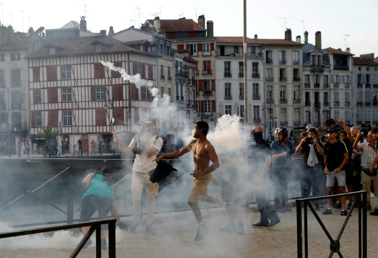 French police used tear gas and water cannon against protesters in nearby Bayonne