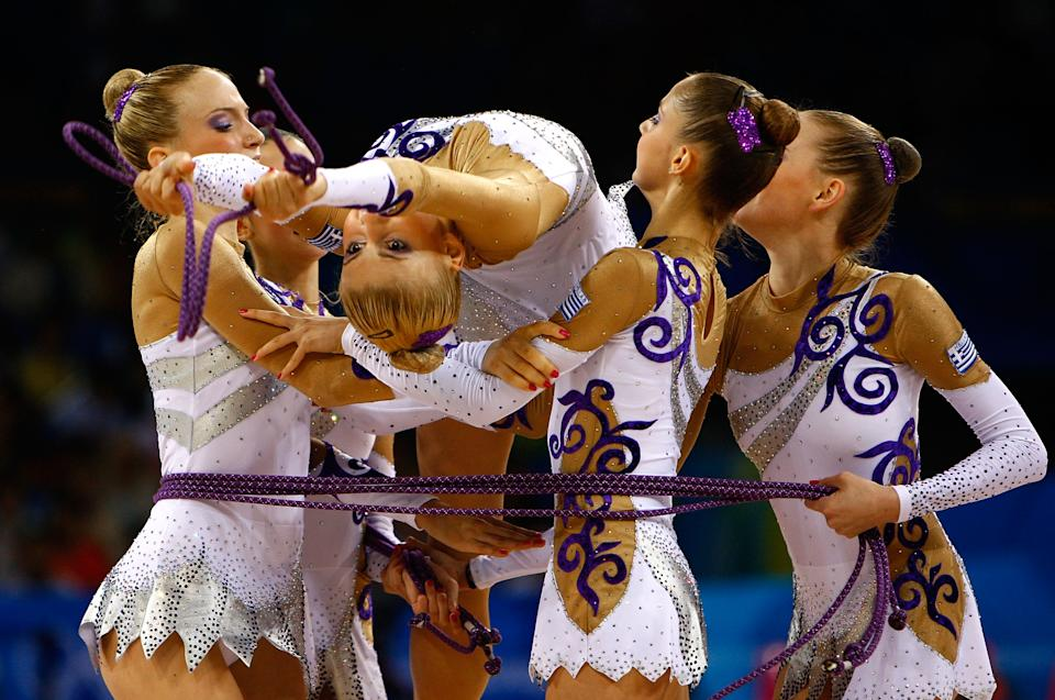 BEIJING - AUGUST 21: The Greek team compete in the Group All-Around Qualification rhythmic gymnastics event held at the Beijing University of Technology Gymnasium during Day 13 of the Beijing 2008 Olympic Games on August 21, 2008 in Beijing, China. (Photo by Jamie Squire/Getty Images)