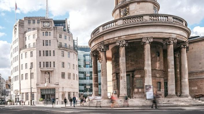 """<span class=""""caption"""">BBC World Service headquarters on Portland Place in London.</span> <span class=""""attribution""""><span class=""""source"""">Willy Barton via Shutterstock</span></span>"""