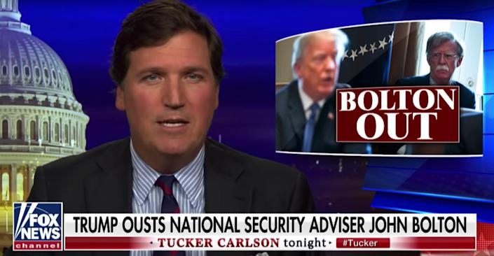 The Fox News host Tucker Carlson reporting (and celebrating) Bolton's departure from the White House in September.