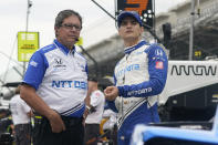FILE - In this Friday, Aug. 13, 2021, file photo, Alex Palou, second from left, of Spain, talks with a crew member before a practice session for a IndyCar auto race at Indianapolis Motor Speedway in Indianapolis. IndyCar is on a two-week break, but the 24-year-old Palou has no plans to rest as he tries to reclaim his spot atop the championship standings. (AP Photo/Darron Cummings, File)