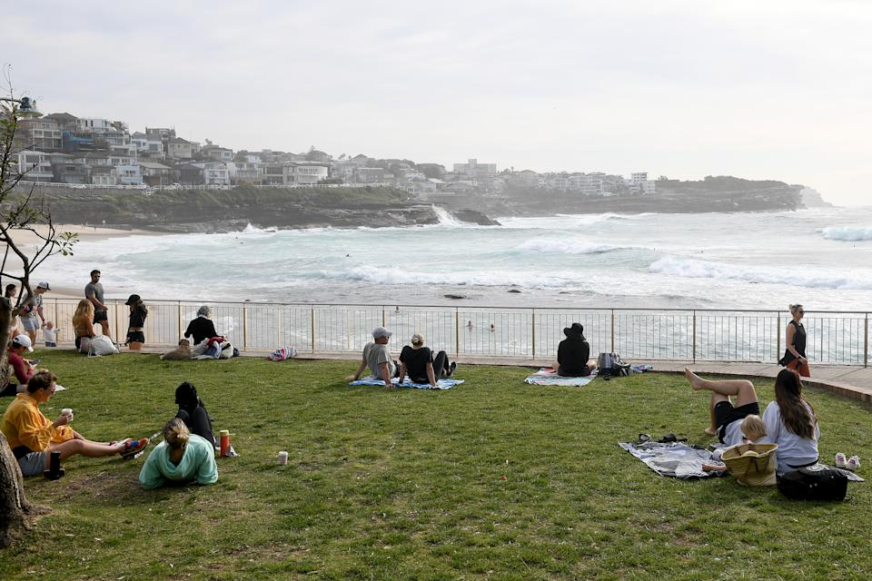 People watch the surf at Bronte beach in Sydney on Saturday, September 18, as the city's lockdown drags on. Source: AAP