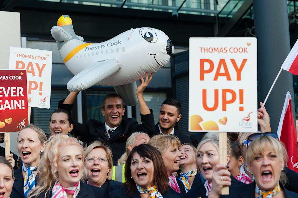 Thomas Cook workers gather at the Department of Business, Energy and Industrial Strategy (BEIS) to protest and hand in a petition with over 10,000 signatures, calling on Secretary of State for Business Andrea Leadsom to ensure the workers affected by the firm's collapse receive their unpaid wages on 02 October, 2019 in London, England. Around 9,000 Thomas Cook employees in the UK lost their jobs on Monday last week as the worlds oldest travel company went into liquidation over its debts. (Photo by WIktor Szymanowicz/NurPhoto via Getty Images)