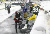 Green Bay Packers' A.J. Dillon has trouble leaping the the stands after running for a touchdown during the second half of an NFL football game against the Tennessee Titans Sunday, Dec. 27, 2020, in Green Bay, Wis. (AP Photo/Mike Roemer)