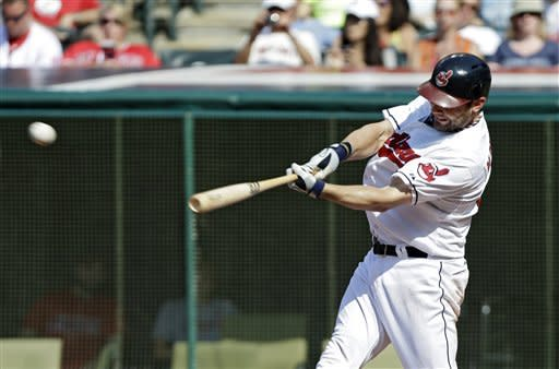 Cleveland Indians' Casey Kotchman hits a three-run home run off Los Angeles Angels relief pitcher Hisanori Takahashi in the second inning of a baseball game Wednesday, July 4, 2012, in Cleveland. (AP Photo/Mark Duncan)