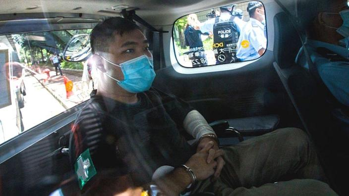 Tong Ying-kit handcuffed inside a police car