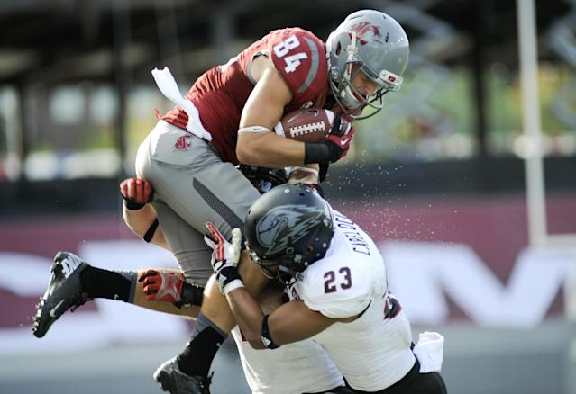Washington State's River Cracraft is forced out of bounds by Southern Utah's Myles Carelock (23) and Matt Holley (7) during the first half of an NCAA college football game, Saturday, Sept. 14, 2013, in Pullman, Wash. (AP Photo/Rajah Bose)