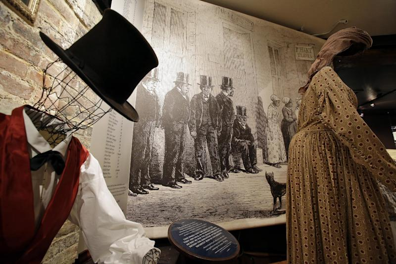 """This photo taken Oct. 31, 2013 shows a of how slaves were dressed for sale, at the Freedom House Museum in Alexandria, Va. A small museum across the Potomac River from the nation's capital is connected to the story depicted in the new movie """"12 Years a Slave."""" The Freedom House Museum is at the site where a major slave trader once operated _ the same slave trader who sold Solomon Northrup into slavery after the free man's abduction. The movie is drawing renewed interest from historians and visitors in this Virginia city's role in the slave trade. (AP Photo/Alex Brandon)"""