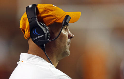 Tennessee head coach Jeremy Pruitt watches from the sideline in the second half of an NCAA college football game against Georgia, Saturday, Oct. 5, 2019, in Knoxville, Tenn. (AP Photo/Wade Payne)