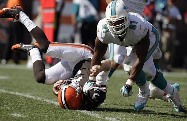 CLEVELAND, OH - SEPTEMBER 08: Defensive end Cameron Wake #91 of the Miami Dolphins sacks quarterback Brandon Weeden #3 of the Cleveland Browns at Cleveland Browns Stadium on September 8, 2013 in Cleveland, Ohio. (Photo by Matt Sullivan/Getty Images)