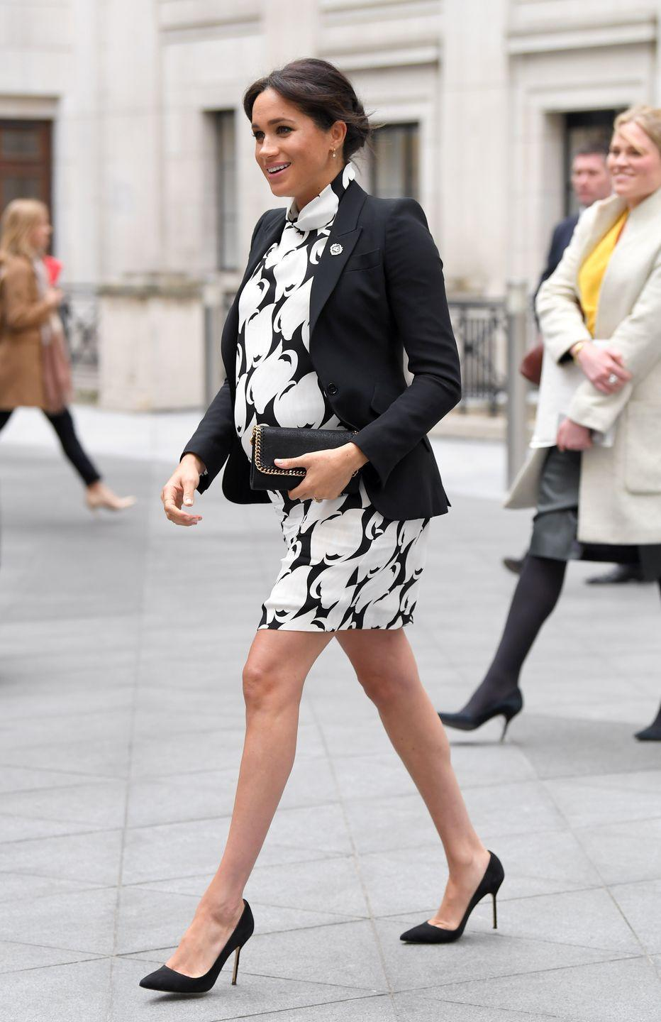 <p>In March 2019, Markle paired a classic black blazer with a black and white dress during an appearance while pregnant with baby Archie. </p>