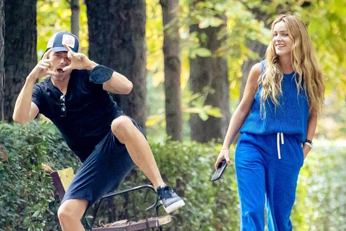 <p>Sebastian Stan playfully acknowledges photographers while on an afternoon stroll with his girlfriend Alejandra Onieva in Madrid on Sept. 1. </p>