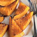 """<p><strong>Recipe: <a href=""""https://www.southernliving.com/syndication/candied-roasted-squash"""" rel=""""nofollow noopener"""" target=""""_blank"""" data-ylk=""""slk:Candied Roasted Squash"""" class=""""link rapid-noclick-resp"""">Candied Roasted Squash</a></strong></p> <p>You'll need just three ingredients and a sheet pan to bake up caramelized squash. Seed and cut one day in advance to save time on the day of your holiday meal. </p>"""