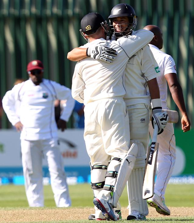 DUNEDIN, NEW ZEALAND - DECEMBER 03: Ross Taylor and Brendon McCullum of New Zealand congratulate each other after both scoring centuries during day one of the first test match between New Zealand and the West Indies at University Oval on December 3, 2013 in Dunedin, New Zealand. (Photo by Rob Jefferies/Getty Images)