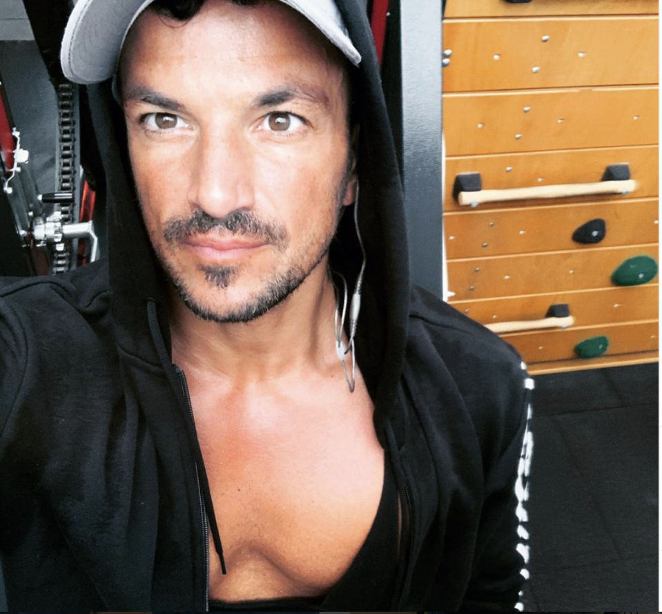 Peter Andre showing his chest off in a hoodie
