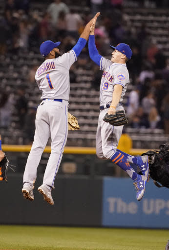 New York Mets' Brandon Nimmo (9) high fives Amed Rosario (1) after the team's 12-2 win over the Colorado Rockies a baseball game, Monday, June 18, 2018, in Denver. (AP Photo/Jack Dempsey)