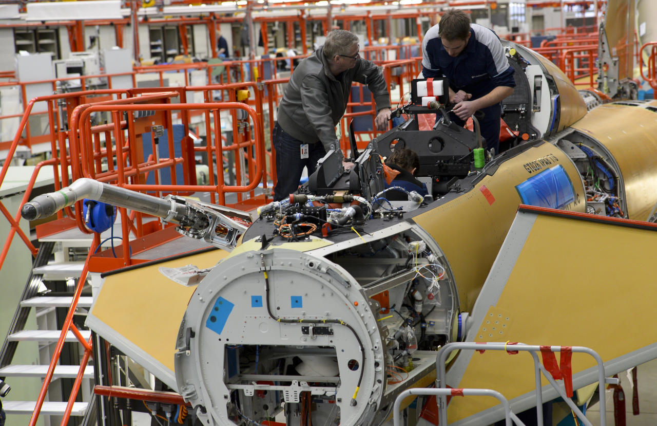 Employees of EADS company Cassidian assemble an Eurofighter plane for the German Air Force at the Cassidian production line in Manching, southern Germany, on February 28, 2013.     AFP PHOTO / GUENTER SCHIFFMANN