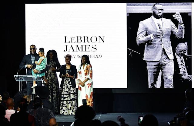 LeBron James accepts the Icon360 award from Harlem's Fashion Row on Tuesday night. (Getty Images)
