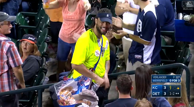 This Tigers vendor had a reason to smile after nonchalantly catching a foul ball. (MLB.com)