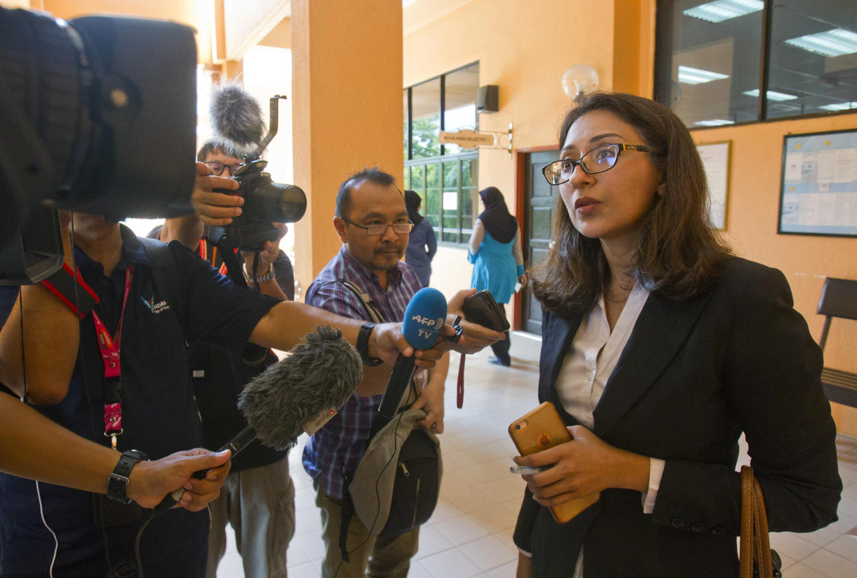 Sangeet Kaur Deo, lawyer for British woman Samantha Jones, speaks to the media after a court hearing at Langkawi Magistrate court in Langkawi, Malaysia, Tuesday, Oct. 30, 2018. Jones is expected to be charged for allegedly stabbing her husband, John William Jones, 62, to death on Oct. 18. (AP Photo/Yam G-Jun)