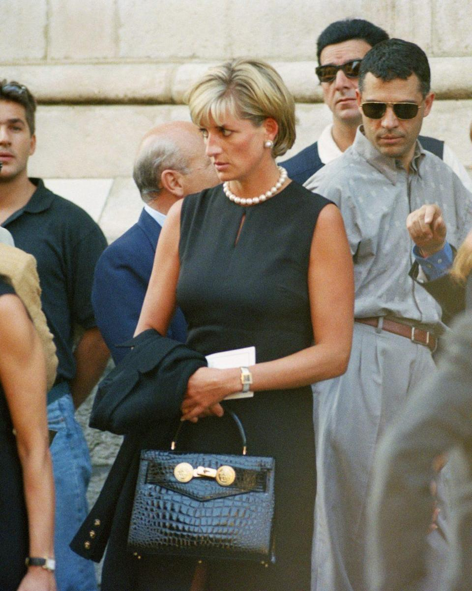 """A Versace bag by her friend Gianni, who said of Diana in 1997, """"It is a moment in her life, I think, when she's found herself – the way she wants to live."""" ALBERTO PIZZOLI"""